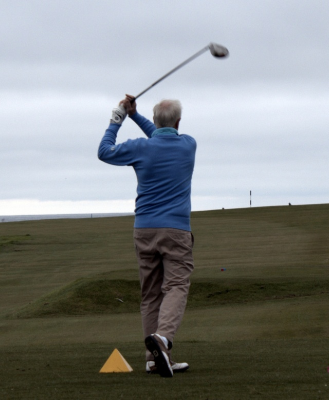 George Norrie drives at the first hole.