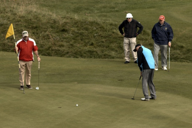 ..and sinks his birdie putt!
